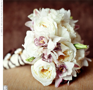 Alicia carried a mostly white bouquet of cymbidium orchids, garden roses, and lisianthus buds.