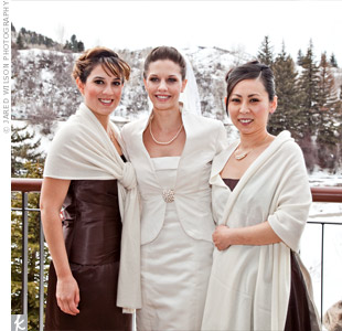 The bridesmaid dresses were custom-made. Alicia bought heavy chocolate brown satin, each girl chose a style she liked, and a seamstress made the dresses. Cashmere shawls, which Alicia found at Saks, kept the girls warm.