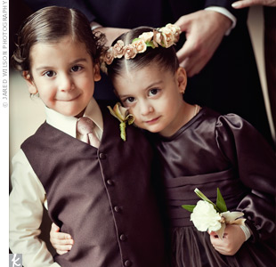 Hilario's twin niece and nephew were the couple's flower girl and ring bearer. Their outfits were custom-made from the same chocolate brown satin as the bridesmaid dresses.