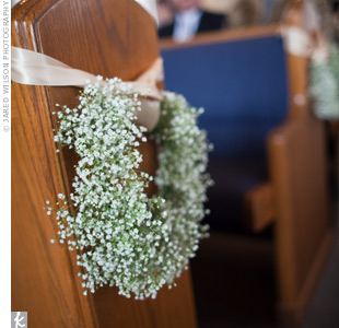 Wreaths of baby's breath were tied with ribbon to decorate the first few pews at the chapel.