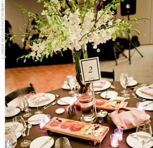 The tables were decorated with elaborate white floral centerpieces hung with crystals. On every table was also a charcuterie and cheese board, for guests to enjoy upon finding their seats.