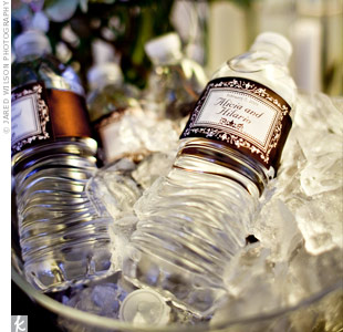 Alicia and Hilario ordered labels with their names and wedding date to customize all of their favors. They added the labels to take-home water bottles at the reception.