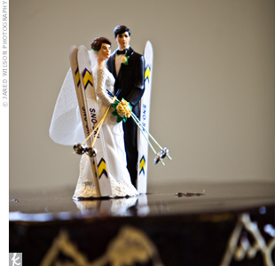 The couple incorporated their love for skiing into the groom's cake (a bittersweet chocolate mousse-covered confection). The catering staff at the Westin found the topper, a bride and groom with skis, online.