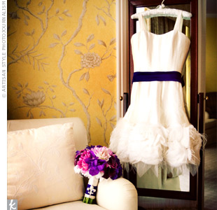Colleen added a purple sash to her knee-length wedding dress with a feather underskirt to incorporate the color of the day.