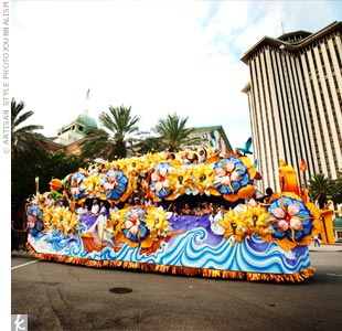 When guests walked out of the ceremony, they were surprised to see real Mardi Gras floats ready to take them to the reception. Everyone threw beads from the floats as they paraded downtown. Colleen and Brad had arranged for the police to block off some of the streets for the processional.