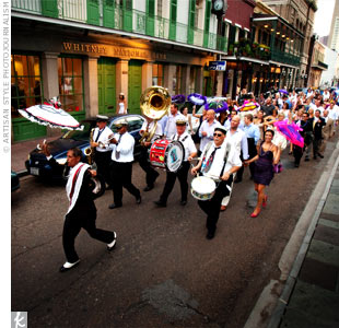 A New Orleans tradition, a second line band escorted the parade to Nola, where the party continued. Colleen and Brad ordered personalized parasols for the wedding party and gave out hankies to all the guests to wave as they walked down the street.