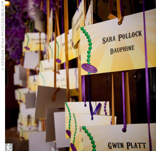 The first thing guests saw as they exited the elevator into the reception was the escort card display: Mardi Gras-themed cards hung on ribbons from a purple floral arrangement. Beneath it, Colleen placed a coffee-table book about New Orleans for everyone to sign as the guest book.