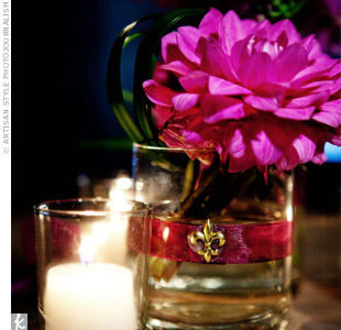 The fleur-de-lis symbol made its way into the centerpieces, pinned to ribbon wrapped around the vases.