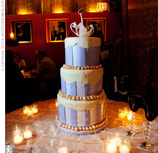 To incorporate the Mardi Gras theme, beads bordered each tier of Colleen and Brad's purple, fondant-covered wedding cake.