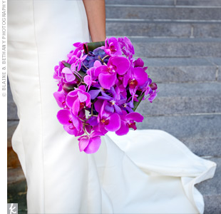 Anh's and Matthew's florist used purple phalaneopsis orchids, Vanda orchids, and ti leaves in Anh's bouquet.