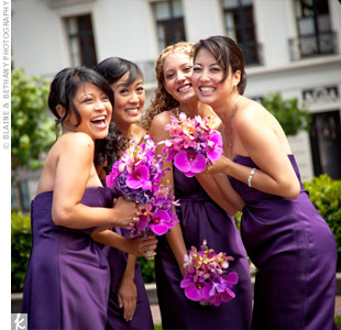 Anh's bridesmaids wore strapless, satin dresses in dark purple. Just like the bride, Phalaenopsis and Vanda orchids were also used to create their bouquets.