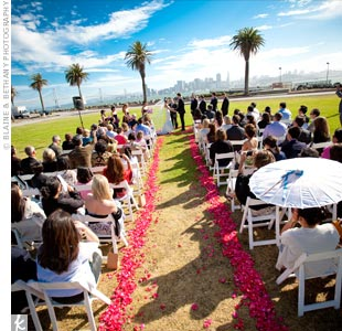The San Francisco skyline was the perfect backdrop for Matthew and Anh's ceremony on Treasure Island's Great Lawn. Purple raspberry rose petals, which the couple bought in bulk online, lined the aisle.