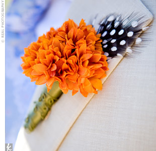 Kara ordered the boutonnieres from Etsy.com, choosing an array of faux carnations and orange blossom flower with earthy accents like spotted feathers.