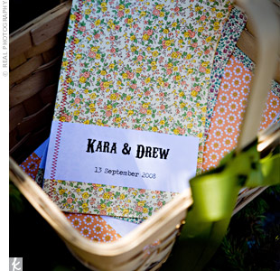 Multicolored patterned paper covered the guest programs that Kara made herself. She sewed the covers to white paper using colored thread.