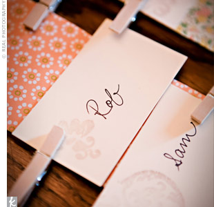 Guests' names were stamped onto simple, rectangular cards, which were attached to patterned paper with miniature clothes pins. Kara snagged the idea from someone else's wedding blog.