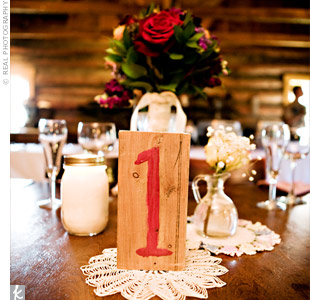 The table numbers were also a DIY project; the couple hand-painted recycled pieces of pine and stood them up on various doilies collected over the years by the bride's family.
