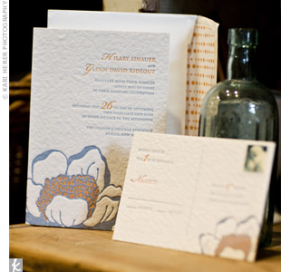 The simple invitations and reply cards were letterpressed with a large magnolia and printed in the couples signature blue and orange.