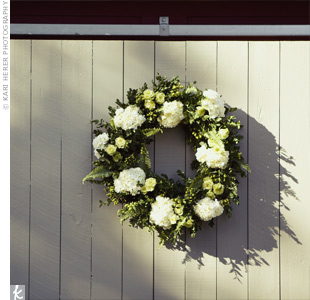 Hydrangea and rose wreaths were hung around the ceremony site to provide a naturally festive touch.