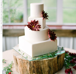 The sleek four-tiered wedding cake was coconut with raspberry and chocolate ganache. After rave reviews from guests at the reception, the couple served the leftovers at their post-ceremony brunch where it was quickly devoured.