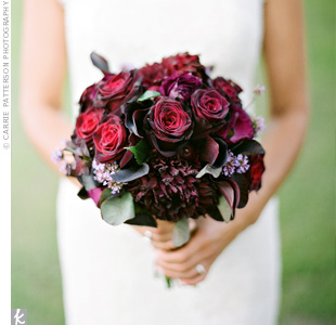 Lia's bridal bouquet was composed of burgundy ranunculus, roses, antique hydrangeas, and Wyoming wildflowers. The florist also mixed in a bit of greenery to complement the gorgeous natural setting.