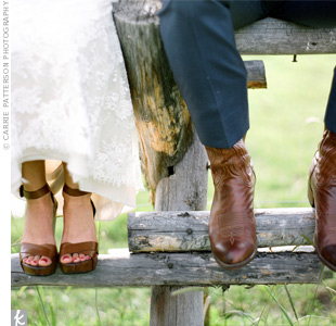 "Lia was thrilled to have to wear grass-friendly shoes. Her leather platforms not only gave her extra height (Mark is 6'5"" and she's 5'7""!), but her comfy kicks made dancing all night a breeze and helped lend a rustic vibe to her lace Monique Lhuillier gown."