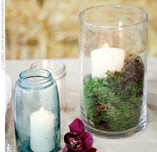 To dress up the buffet table, the bride had candles set in jars and hurricane vases filled with moss. A few orchids strewn between the candles completed the look.