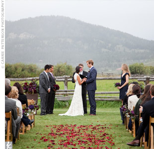 Shirking tradition, Lia and Mark had their own siblings stand next to them at their wedding ceremony -- Lia's brothers on her side, Mark's sister on his. A rose petal-strewn aisle and the foggy surrounding hills created the perfect setting for the outdoor ceremony.