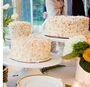 Instead of a traditional tiered cake, the couple served three coconut cream cakes ordered from a bakery in Portland, where they fell in love. Vases overflowing with white tulips and hydrangeas decorated the cake table.