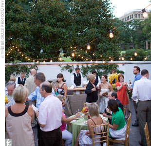 Guests mingled as they walked through the hall's rooms and patios to visit the different food stations. Strands of twinkling lights added a romantic touch to the outdoor patio areas.