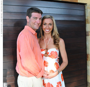 The hosts designated dressy-tropical as the attire for the occasion and coordinated in a white dress with orange, Art Deco flowers for her and linen pants with a matching shirt for him.