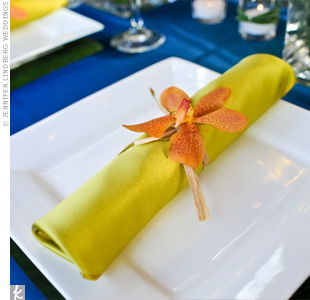 A yellow napkin and a single, orange Mokara orchid gave each place setting an exotic pop of color.