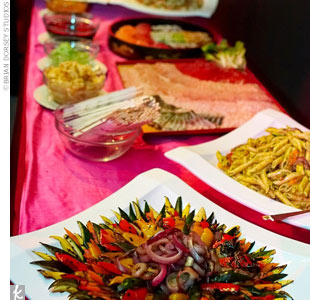 The buffet, set with pink table linens, had a variety of delicious options, including fresh pesto pasta, sauteed onions and peppers, and fresh sashimi and sushi.