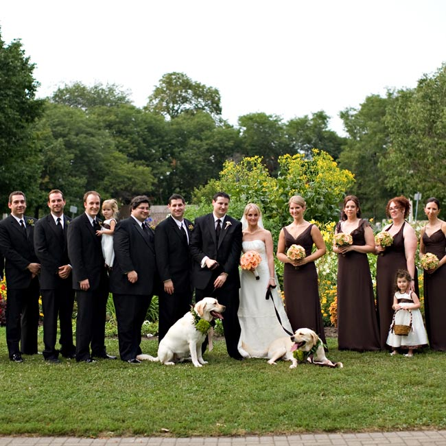 The men kept things classic in traditional black tuxedos, while the bridesmaids mixed it up by choosing brown chiffon dresses in complementary styles. The couple's dog and the best man's dog served as ring bearers and wore collars of foliage tied with peach and brown ribbons.