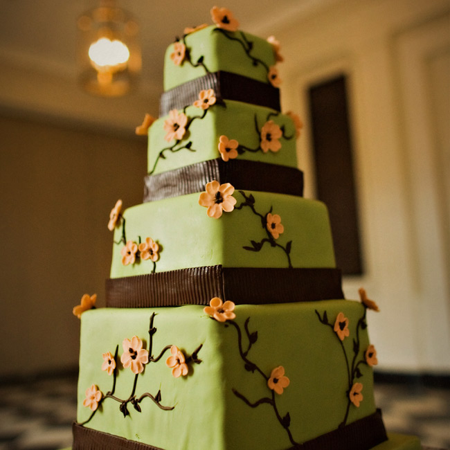 For a sophisticated summer style, dainty peach flowers dotted each side of the four-tiered, branch-themed cake