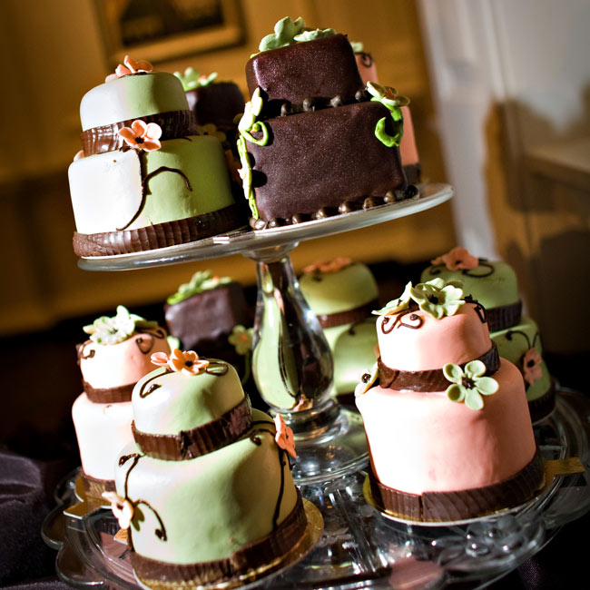 To celebrate the couple's love of dessert, guests nibbled on treats from a sweet station complete with 36 mini cupcakes, 12 two-tiered mini replicas of the cake in pink, chocolate and mint and petit fours rounded out the desserts—yum!