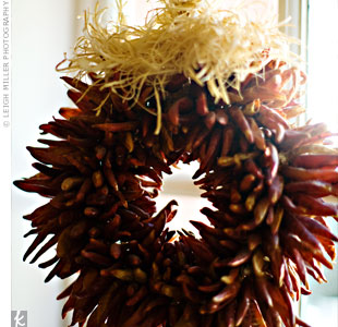 The couple chose the space for its Southwestern details, including this typical wreath of red chilis strung with hay that was hanging from the gallery's ceiling.