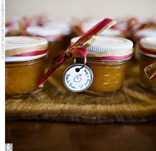 Jars of pear-ginger and peach-rum jam served as both escort cards and favors. Amy made the jam while her mother wrapped jars with red-and-white straw ribbon and wrote each guest's name in calligraphy on top.