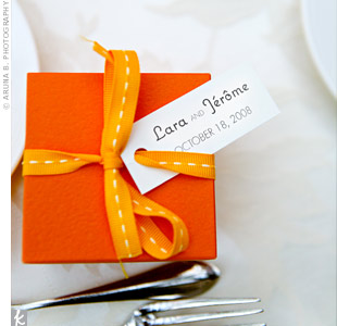 To pay homage to the groom's French upbringing, guests took home French chocolates and candied almonds. Orange boxes and yellow ribbons coordinated with the rest of the day's details.