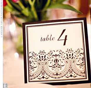 The table cards were printed on ivory paper with a black design at the bottom, and were mounted to black cardstock. The black-and-white combo matched the bridesmaid looks.