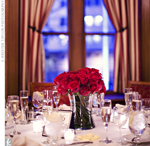 Each reception table had an all-red arrangement of roses, tulips, or gerbera daisies. The vases varied too, from cylinders to squaresto bubble bowls for an eclectic style.