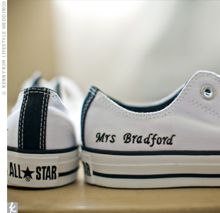 Erika had a pair of Converse All-Stars embroidered with the phrase Mrs. Bradford. Cory had a matching pair printed with Mr. Bradford.