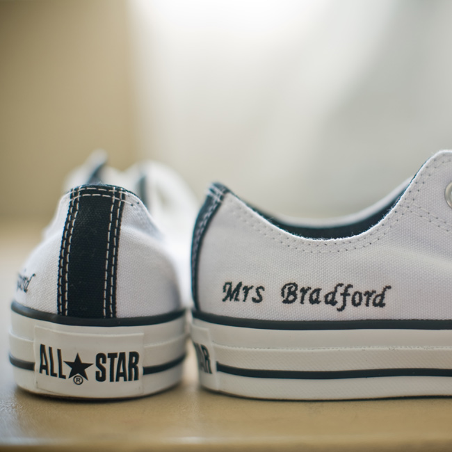 "Erika had a pair of Converse All-Stars embroidered with the phrase ""Mrs. Bradford."" Cory had a matching pair printed with ""Mr. Bradford."""