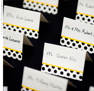 Guests' names were handwritten on cards which had a polka-dot design in the couple's wedding palette.