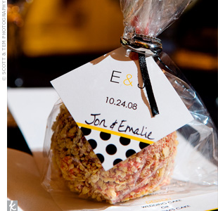 Guests took home bags decorated with a damask pattern and filled with candy apples, a nod to the October wedding date.