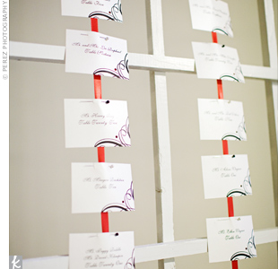 Small pins attached card stock to bright strands of ribbon. The couple kept the design on the cards simple, since the vertical display was already eye-catching.