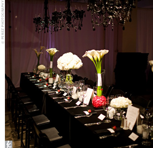 "Calla lilies and roses popped out of the scene with dark tablecloths, chairs, and chandeliers. ""I wanted it to have a swanky feel,"" says Rachel."
