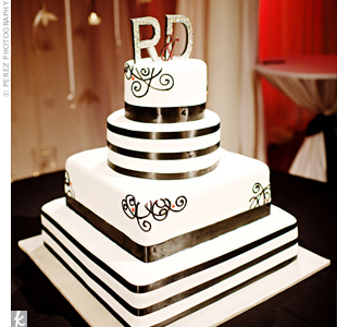 The couple's silver monogram topped the four-tiered, buttercream-frosted cake. Strips of chocolate frosting made the cake appear larger than life.