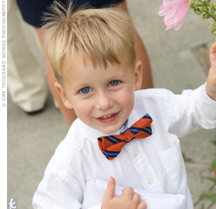 The ring bearer wore an orange and blue striped bowtie so that he coordinated with the rest of the guys.