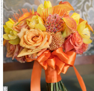 Fitting of a bright orange and blue color scheme, Nikki's bridal bouquet was made with a mix of fresh orange and yellow roses, pincushion mums, dahlias, calla lilies, and orchids.
