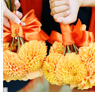 Nikki's bridesmaids carried bouquets of orange and yellow dahlias, tied together with an orange ribbon.